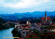 A view of the town of Steyr, in particular the old town square from Tabor, a hill on the northern bank of the Enns River with  surrounding hills to the south of the town.  The most prominent tower in the photo is that of the Stadtpfarrkirche.