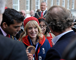 © Licensed to London News Pictures. 03/03/2014; Bristol, UK.  Jenny Jones, Olympic Bronze medallist in snowboarding, arrives at Bristol's College Green by open top bus, during a celebratory parade through Bristol.<br /> Photo credit: Simon Chapman/LNP