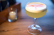Float Like a Dragonfly Cocktail with mezcal, pisco, pineapple, lemon, bitters, and egg white at Bartaco restaurant at Hilldale Shopping Center in Madison, WI on Thursday, April 18, 2019.