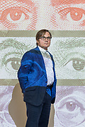 """London, UK, May 21 2018 - Portrait of Matthew Greenburgh in front of his artwork """"Annuit Cœptis"""" at the Degree Show of University of the Arts London (Central Saint Martins).  Matthew Greenburgh  is a former banker who worked on two takeovers that became synonymous with the credit crunch. He has moved from finance to photography since quitting Bank of America Merrill Lynch seven years ago. Mr. Greenburgh and BAML advised Royal Bank of Scotland Group PLC on its 2007 acquisition of parts of ABN Amro Holding NV and Lloyds Banking Group PLC when it purchased HBOS PLC the following year. Both deals helped ensure these banks needed multibillion-pound bailouts from the British taxpayer during the financial crisis. Having made his fortune advising ambitious banking chiefs like RBS's Fred Goodwin, Mr. Greenburgh has become a photographer."""