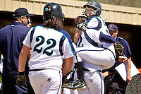 Lake City High's Dakota Wilson is lifted by her teammate as they celebrate Wilson's solo homerun Friday that won the game against Rocky Mountain High in the State 5A tournament at Post Falls High School.