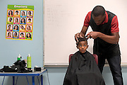 """He loves haircuts,"" says Natisha Montanez about her son, Liam White, 4, who gets a free haircut from Kevon Roberts at the Thirman L. Milner School in Hartford, Conn. during an openhouse event in August 2016. Liam starts pre-school next Tuesday. For the first time at the school, thirty regular haircuts (for boys only) were offered for free at the school. Catholic Charities sponsored the haircuts which were provided by ProStyle BarberShoip in Hartford. Roberts is a barber at ProStyle."