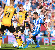 Hull City midfielder Sam Clucas shields the ball from Brighton striker Sam Baldock during the Sky Bet Championship match between Brighton and Hove Albion and Hull City at the American Express Community Stadium, Brighton and Hove, England on 12 September 2015. Photo by Bennett Dean.