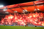 Legia's supporters with fireworks during the UEFA Champions League play-off second leg match between Legia Warsaw and FC Steaua Bucuresti at Pepsi Arena Stadium in Warsaw on August 27, 2013.<br /> <br /> Poland, Warsaw, August 27, 2013<br /> <br /> Picture also available in RAW (NEF) or TIFF format on special request.<br /> <br /> For editorial use only. Any commercial or promotional use requires permission.<br /> <br /> Photo by © Adam Nurkiewicz / Mediasport