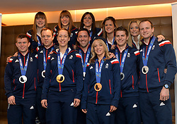 Pictured front left is gold medal winner Lizzy Yarnold and front right Bronze medalist Jenny Jones.<br /> Team GB Return from the Sochi 2014 Olympic Winter Games to Heathrow Airport, London, UK.<br /> Monday, 24th February 2014. Picture by Ben Stevens / i-Images