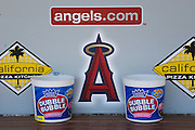 ANAHEIM, CA - JULY 21:  The team logo and corporate logos adorn the dugout wall as bubble gum awaits the Los Angeles Angels of Anaheim game against the Texas Rangers on July 21, 2011 at Angel Stadium in Anaheim, California. The Angels won the game in a 1-0 shutout. (Photo by Paul Spinelli/MLB Photos via Getty Images)