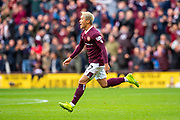 Ryotaro Meshino (#77) of Heart of Midlothian FC runs off to celebrate after scoring the opening goal during the Ladbrokes Scottish Premiership match between Heart of Midlothian and Rangers FC at Tynecastle Park, Edinburgh, Scotland on 20 October 2019.