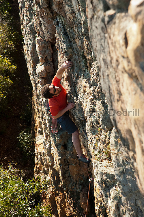 "Andrew Berge climbing ""Silverado Squatters"" 5.10b, at the Bear Cliff, Mount St. Helena, Napa Valley, California"