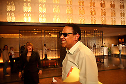 Ala'a Al-Aswany jokes after lunch with Mark Linz and Nabila Akl, the director and promotions manager for his local publishers, The American University in Cairo Press in Cairo, Eqypt on April 4, 2008. Al-Aswany is a prominent Egyptian writer and founding member of the political movement Kefaya. Trained as a dentist in Cairo and Chicago, Al-Aswany has contributed numerous articles to Egyptian newspapers on literature, politics, and social issues. His second novel, The Yacoubian Building, an ironic depiction of modern Egyptian society, has been widely read in Egypt and throughout the Middle East. It was translated into English and was adapted into a film (2006) and a television series (2007) of the same name. Chicago, Al-Aswany's latest novel, is set in the American city where he had attended college.