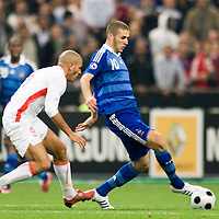 14 October 2008: French midfielder Karim Benzema #10 vies with Tunisian Yassine Mikari (left) during the friendly football match won 3-1 by France over Tunisia on October 14, 2008, at the Stade de France in Saint-Denis, near Paris, France.