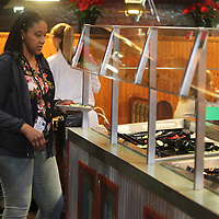 Adam Robison | BUY AT PHOTOS.DJOURNAL.COM<br /> Nichole Johnson, of Tupelo, gets her salad prepared at the salad bar at Bonanza in Tupelo on Wednesday.