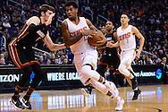 Jan 3, 2017; Phoenix, AZ, USA;  Phoenix Suns forward Marquese Chriss (0) drives the ball in front of Miami Heat forward Luke Babbitt (5) in the first half of the NBA game at Talking Stick Resort Arena. Mandatory Credit: Jennifer Stewart-USA TODAY Sports