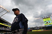 Storm clouds are seen as Tampa Bay Rays manager Joe Maddon (70) walks to the dugout before their baseball game against the Kansas City Royals at Kauffman Stadium in Kansas City, Mo., Wednesday, May 1, 2013.  (AP Photo/Colin E. Braley).