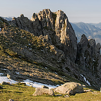 Still moving from &quot;Refuge de Prati&quot; to Cozzano. The GR20 can be a great experience if you have a good fitness base, the right equipment and if you can, sometimes, take the right decisions. In 2007 three hikers died of hypothermia and two years before a group of people, most of them suffering from hypothermia - some people wearing tennis shoes, - were evacuated by helicopter.<br /> During our trip there was just a small number of hikers walking along the famous high level route, and there was a reason for that. Before we started our trip, we were dissuaded to start the GR20 trekking because of many snow-capped areas making hiking very difficult and dangerous. Later, at the end of our first stage, some french hikers told us that they were blocked for many days in a refuge because of the severe weather. Unfortunately we had no climbing irons and no appropriated sleeping bags. So, before we started, we knew already, that our tent became an useless burden. <br /> That was very demotivating.