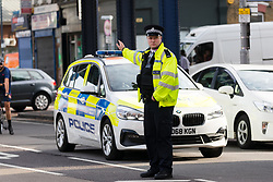 © Licensed to London News Pictures. 08/08/2019. London, UK.  Police at the scene in Leyton this morning in Leyton High Road, where a police officer has been left in a critical condition after being stabbed repeatedly whilst attempting to stop a van in east London. The injured Police Officer, believed to be aged in his thirties, was rushed to hospital and is in a critical but stable condition..  Photo credit: Vickie Flores/LNP