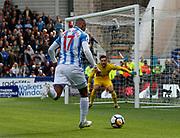 Huddersfield Town's Rajiv van La Parra bears down on Hugo Lloris of Tottenham during the Premier League match between Huddersfield Town and Tottenham Hotspur at the John Smiths Stadium, Huddersfield, England on 30 September 2017. Photo by Paul Thompson.