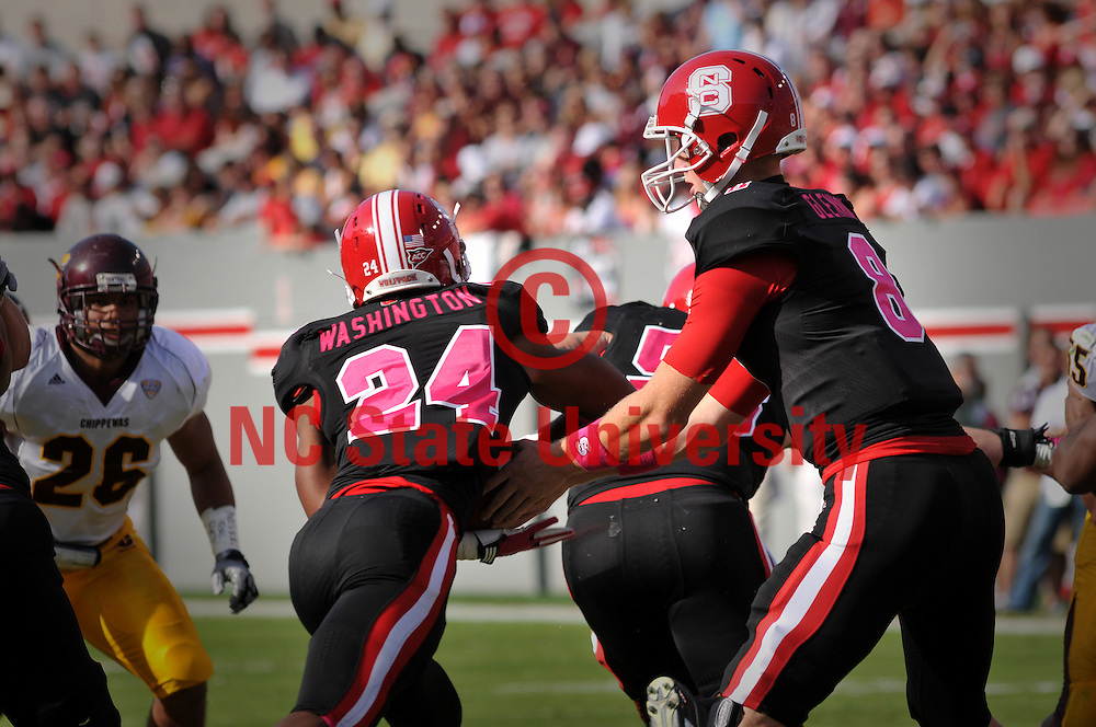 NC State quarterback Mike Glennon (8) hands off to running back James Washington.
