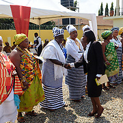 Queen Mothers being congratulated by a judge after having been sworn-in at a ceremony in Accra, Ghana on 23 June 2015. A queen mother is a traditional female leader, drawn from the relevant chiefly lineage, who is responsible for women's and children's issues in particular. Though often widely respected and sometimes powerful, especially in matrilineal ethnic groups, their authority is subject to a male chief. After being suppressed during the colonial era, the role of queen mother is being revived in Ghana and is seen by many as a force for development. Interestingly, modern constructs such as the law are being used to enshrine this ancient role.