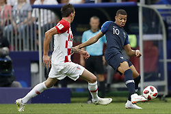 (L-R) Mario Mandzukic of Croatia, Kylian Mbappe of France during the 2018 FIFA World Cup Russia Final match between France and Croatia at the Luzhniki Stadium on July 15, 2018 in Moscow, Russia
