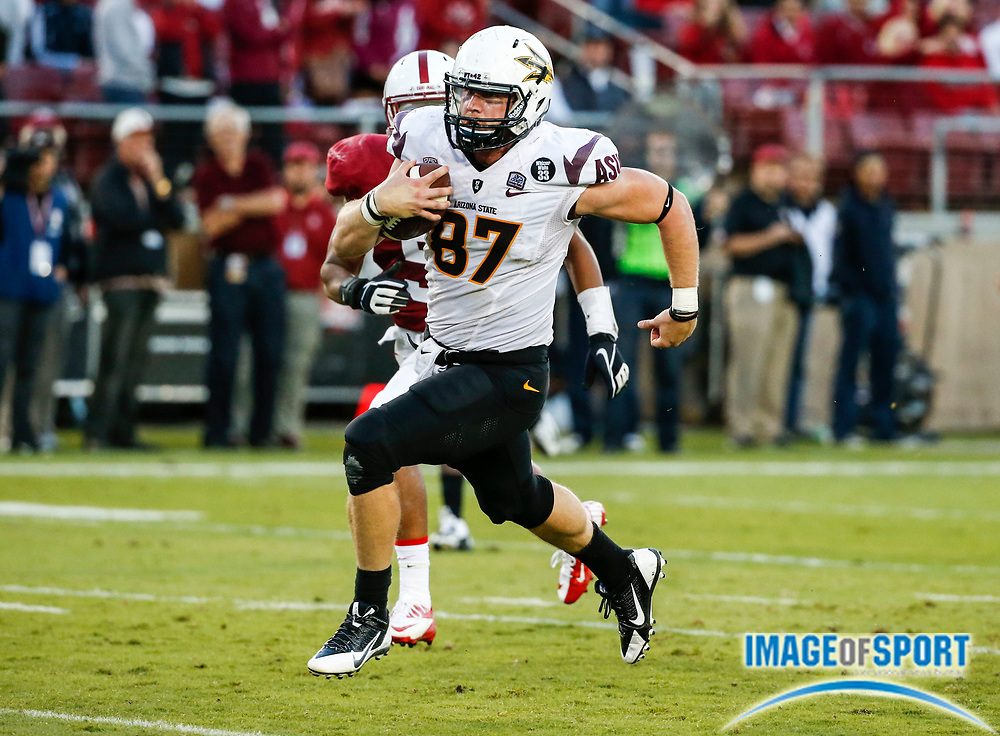 Sep 28, 2013; Stanford, CA, USA: Arizona State Sun Devils tight end Chris Coyle (87) catches a 45-yard touchdown pass in game against the Stanford Cardinal at Stanford Stadium. Stanford defeated Arizona State 42-28.