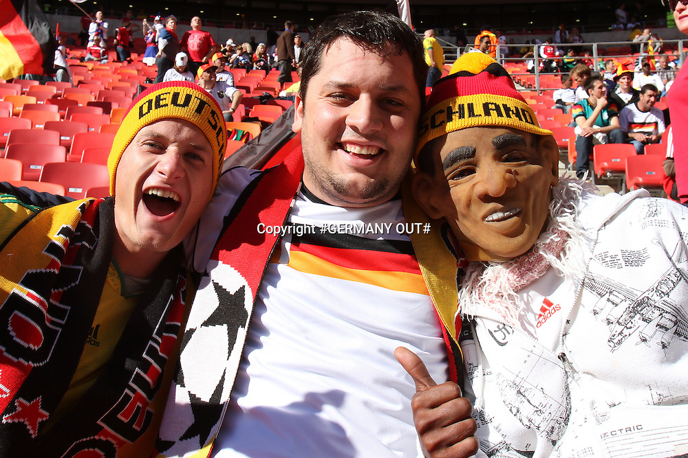 Fans enjoy the atmosphere during the FIFA World Cup 2010 South Africa pool match between Germany and Serbia held at The Nelson Mandela Bay Stadium in Port Elizabeth, South Africa on the 18th June 2010<br /> <br /> Photo by Ron Gaunt/SPORTZPICS<br /> <br /> #GERMANY OUT#