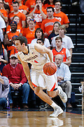 CHARLOTTESVILLE, VA - DECEMBER 4: Evan Nolte #11 of the Virginia Cavaliers handles the ball against the Wisconsin Badgers during the Big Ten/ACC Challenge game at John Paul Jones Arena on December 4, 2013 in Charlottesville, Virginia. Wisconsin won 48-38. (Photo by Joe Robbins) *** Local Caption *** Evan Nolte