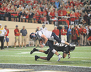 Mississippi quarterback Bo Wallace (14) scores over Vanderbilt defensive back Andrew Williamson (32) in Nashville, Tenn. on Thursday, August 29, 2013. Ole Miss won 39-35.