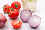 Cut and whole Purple (red) onion with tomatoes and fennel bulbs on white Background
