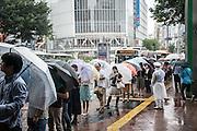 People walking under the rain. Typhoon number 10 called Lionrock hit japan early on morning, in Tokyo. 30/08/2016-Tokyo, JAPAN