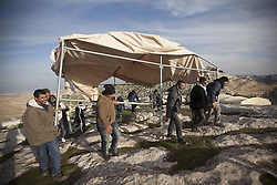 Palestinians build a tent in the new village named Bab al-Shams ( Gate of the Sun ) between Jerusalem and the Jewish settlement of Maale Adumim in the Israeli-occupied West Bank, in an area where Israel has vowed to build new settler homes, on Jan. 12, 2013. The Israeli occupation administration gave Palestinian activists an ultimatum to quit the protest camp in part of the West Bank, but hours after the deadline passed, there was no sign of any Israeli move to evict the protesters, January 12, 2013. Photo by Imago / i-Images...UK ONLY