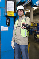 Man holding telephone out towards camera newspaper factory