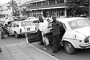 Downtown Kisumu, Kenya's second city, is busy. Public transportation, usually by taxi, is cheap. A taxi will not leave until it is full. To get a full car a 'tout' is employed to encourage people to take his car.
