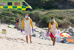 © Licensed to London News Pictures. 31/05/2020. Padstow, UK. RNLI Lifeguards attend an incident on Constantine beach on the north coast of Cornwall this afternoon. Yesterday the RNLI reinstated their beach lifeguard service, having not provided the usual lifeguard service for this time of year in Cornwall, due to Coronavirus (COVID-19). Photo credit : Tom Nicholson/LNP