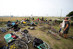 "© Licensed to London News Pictures. 30/08/2015. Calais, France. Around a hundred British cyclists from ""Bikes Beyond Borders"" gather at their arrival to Calais from London as they are to donate bicycles to the people in the refugee camp, also known as the Jungle, as well as supplies to support the life at the site. Photo credit : Isabel Infantes/LNP"