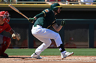 MESA, AZ - MARCH 09:  Matt Joyce #23 of the Oakland Athletics singles in the first inning in the spring training game against the Cincinnati Reds at HoHoKam Stadium on March 9, 2017 in Mesa, Arizona.  (Photo by Jennifer Stewart/Getty Images)