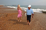 Michael CAMPBELL (NZ) with his wife Julie at home on Brighton beach after winning his first major with the US Open trophy he won at Pinehurst,USA during summer at Brighton,East Sussex,England.