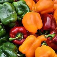 Green, Yellow and Red Bell Peppers at Market in Annecy, France