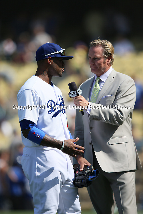 LOS ANGELES, CA - APRIL 28:  Carl Crawford #25 of the Los Angeles Dodgers gets interviewed after the game by a FOX Sports reporter after hitting two home runs against the Milwaukee Brewers on Sunday, April 28, 2013 at Dodger Stadium in Los Angeles, California. The Dodgers won the game 2-0. (Photo by Paul Spinelli/MLB Photos via Getty Images) *** Local Caption *** Carl Crawford