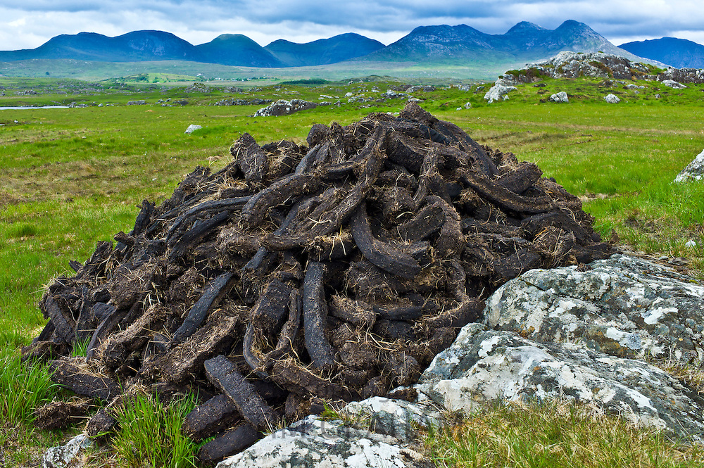 Stacked peat in turf bog on the Old Bog Road near Roundstone, Connemara, County Galway