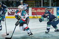 KELOWNA, CANADA - APRIL 25: Scott Eansor #8 of the Seattle Thunderbirds stick checks Dillon Dube #19 of the Kelowna Rockets from behind on April 25, 2017 at Prospera Place in Kelowna, British Columbia, Canada.  (Photo by Marissa Baecker/Shoot the Breeze)  *** Local Caption ***