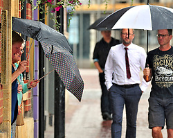 © Licensed to London News Pictures. 09/08/2018<br /> Tonbridge, UK. Wet weather for shoppers in Tonbridge High Street, Tonbridge, Kent as the heatwave across the south east comes to an end.<br /> Photo credit: Grant Falvey/LNP