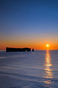 SUnrise and Rocher percé  (Percé Rock) on the Atlantic Ocean<br /> Percé <br /> Quebec<br /> Canada