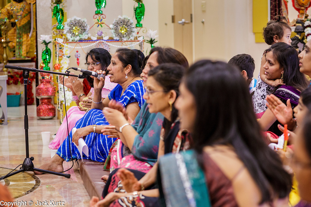 10 AUGUST 2012 - PHOENIX, AZ: Women sing and pray during the celebration of Janmashtami at Ekta Mandir, a Hindu temple in central Phoenix. Janmashtami is the Hindu holy day that celebrates the birth of Lord Krishna. Hindu communities around the world celebrate the holy day. In Arizona, most of the Hindu temples in the Phoenix area have special celebrations of the day.  PHOTO BY JACK KURTZ