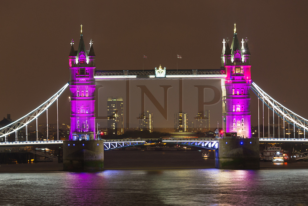 © Licensed to London News Pictures. 02/05/2015. London, UK. Tower Bridge in London is illuminated in pink to celebrate the birth of a baby daughter to Catherine Duchess of Cambridge and Prince William today. Photo credit : Vickie Flores/LNP