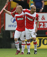 London - Sunday, May 3rd, 2009: Nicky Bailey (L) of Charlton Athletic congratulates Deon Burton on his and Charlton's third goal during the Coca Cola Championship match at The Valley, London. (Pic by Mark Chapman/Focus Images)