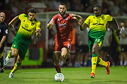 Ben Godfrey (Norwich), Ollie Palmer (Crawley Town)  & Ibrahim Amadou (Norwich) during the EFL Cup match between Crawley Town and Norwich City at The People's Pension Stadium, Crawley, England on 27 August 2019.
