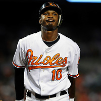 29 June 2009:  Baltimore Orioles center fielder Adam Jones (10) reacts after striking out in the 6th inning against the Boston Red Sox at Camden Yards in Baltimore, MD.  The Red Sox defeated the Orioles 4-0.  ****For Editorial Use Only****