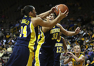 26 JANUARY 2009: Michigan guard Jessica Minnfield (34) and Michigan guard/forward Carmen Reynolds (33) grab a rebound during the first half of an NCAA women's college basketball game Monday, Jan. 26, 2009, at Carver-Hawkeye Arena in Iowa City, Iowa. Iowa defeated Michigan 77-69.