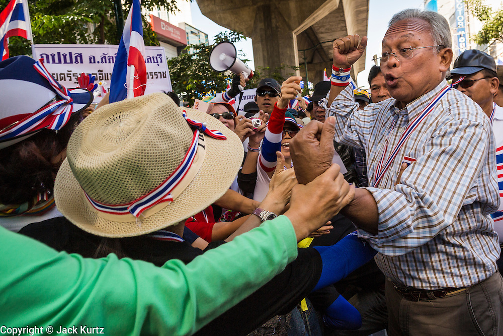 "15 JANUARY 2014 - BANGKOK, THAILAND: SUTHEP THAUGSUBAN, former Deputy Prime Minister of Thailand and leader of the Shutdown Bangkok anti-government protests, talks to supporters on Sukhumvit Road in Bangkok during a protest march. Tens of thousands of Thai anti-government protestors continued to block the streets of Bangkok Wednesday to shut down the Thai capitol. The protest, ""Shutdown Bangkok,"" is expected to last at least a week. Shutdown Bangkok is organized by People's Democratic Reform Committee (PRDC). It's a continuation of protests that started in early November. There have been shootings almost every night at different protests sites around Bangkok. The malls in Bangkok are still open but many other businesses are closed and mass transit is swamped with both protestors and people who had to use mass transit because the roads were blocked.    PHOTO BY JACK KURTZ"