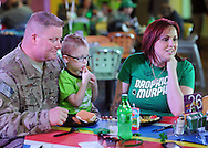 LANGHORNE, PA -  MARCH 15:  Tec Sgt. Justin Bright sits with his wife Tiffany Bright (R) and his son Gerrin Bright (C), 4, after returning from Iraq at Sesame Place March 15, 2014 in Langhorne, Pennsylvania.  (Photo by William Thomas Cain/Cain Images)